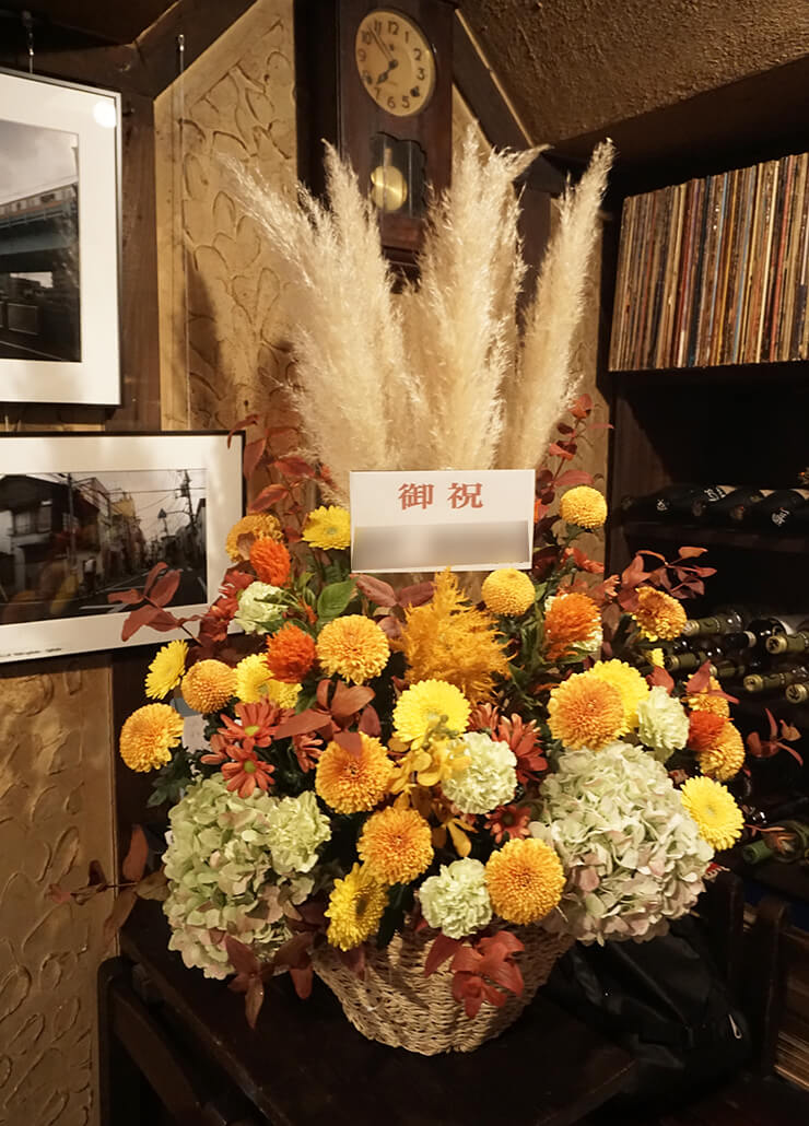 写真展開催祝い花