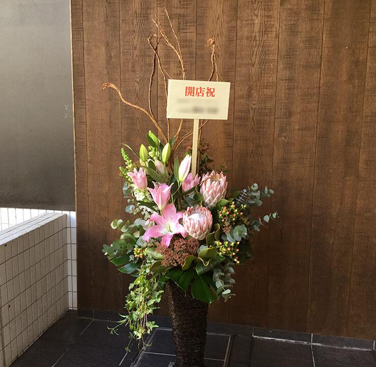 港区開店祝い籠スタンド花