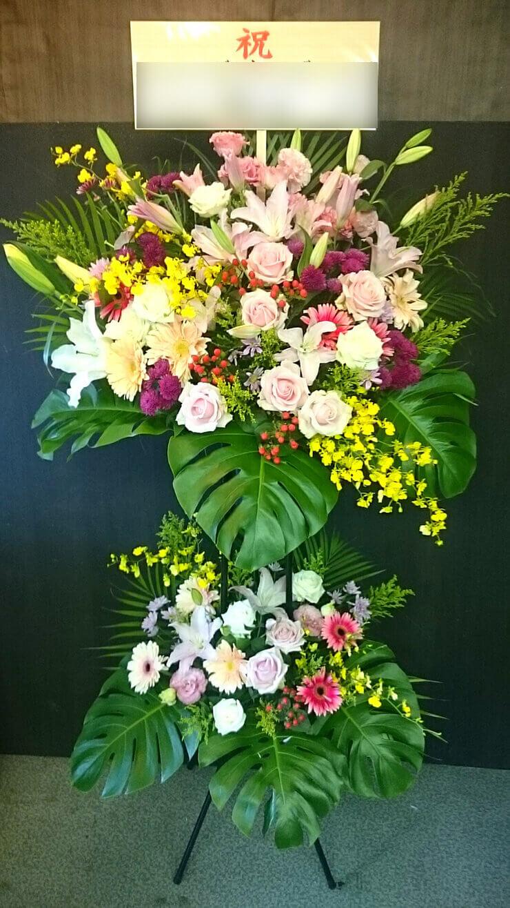 カラオケまねきねこ高円寺南口店様の開店祝いスタンド花