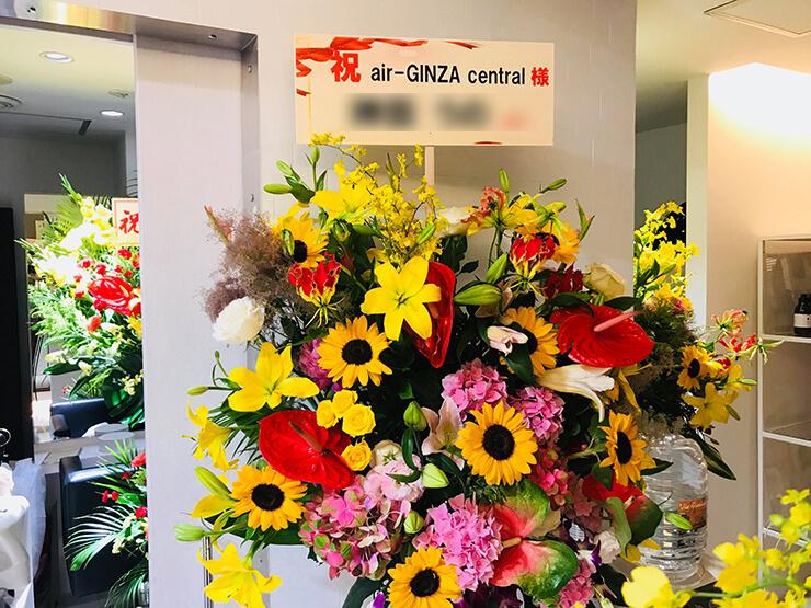 銀座 air-GINZAcentral様の開店祝い黄色系スタンド花